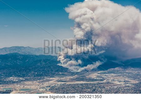 Fires burning in the mountains in north Los Angeles in the daytime from aircraft