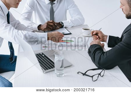 Multiethnic Businessmen Discussing Project