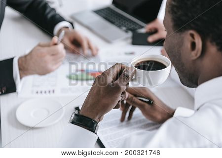 African American Businessman With Cup Of Coffee