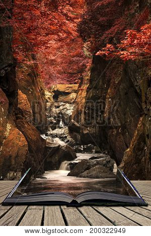 Stunning Ethereal Landscape Of Deep Sided Gorge With Rock Walls And Stream Flowing Through Surreal D