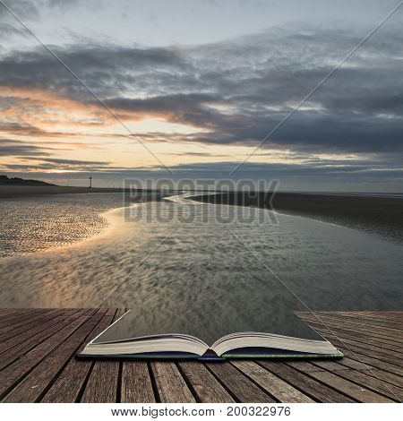 Stunning Colorful Winter Sunrise Over Low Tide Beach  Concept Coming Out Of Pages In Open Book