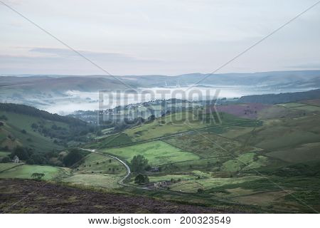 Stunning Dawn Sunrise Landscape Image From Higger Tor Towards Hope Valley Layered In Fog In Summer I