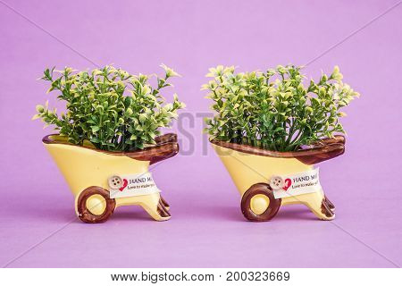 Small Decorative Artificial Plants In Yellow Pots