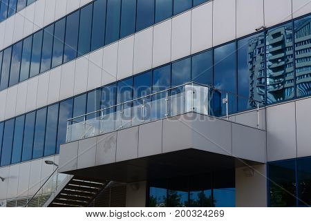 Mirrored Business office Building with cloudly sky mirror reflection
