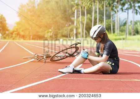 Girl has sport accident injur at her knee from bicycle Sport and Accident concept