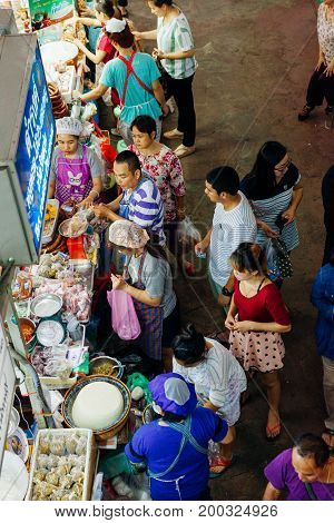 CHIANG MAI THAILAND - AUGUST 27: A group customers crowds near the food stall at the Warorot market on August 27 2016 in Chiang Mai Thailand.