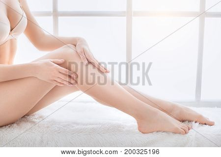 Young female body care at home smooth skin