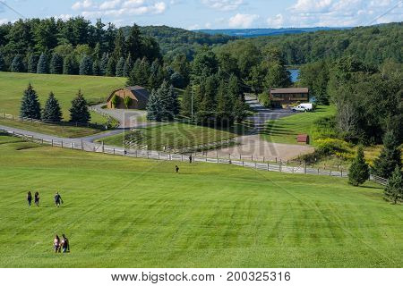 BETHEL NEW YORK - August 13 - People enjoy a nice Summer day and historic view on the actual concert grounds of the Woodstock Festival on August 13 2017 in Bethel NY.