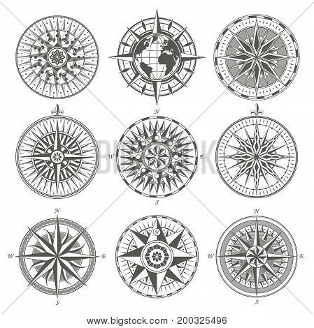 Set of vintage antique wind rose nautical compass signs labels emblems elements. Vector illustration.