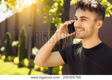 Young male exercise in the park phone call