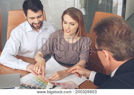 Young couple consultation with agent purchase rent property real estate choice