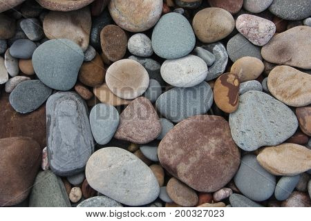 Rocks and stones on a Lake Superior beach.   Pictured Rocks National Lakeshore, Upper Peninsula of Michigan