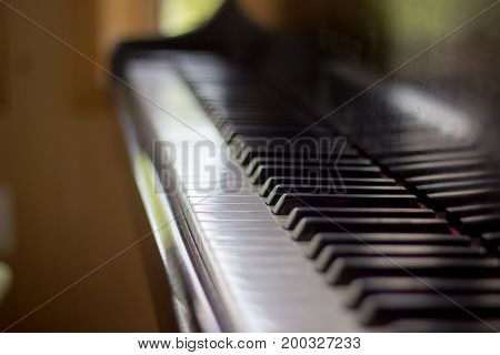 close up of a piano keyboard with narrow field of focus