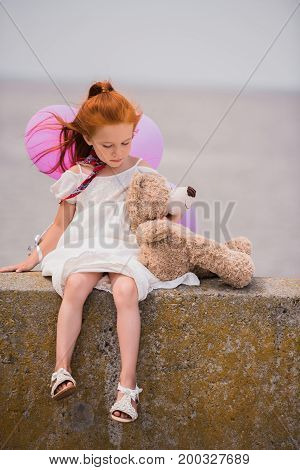 Child With Teddy Bear And Balloons
