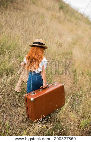 Child With Suitcase And Teddy Bear