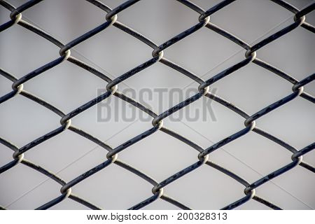 Close up Steel cage pattern background Safety and Defence concept