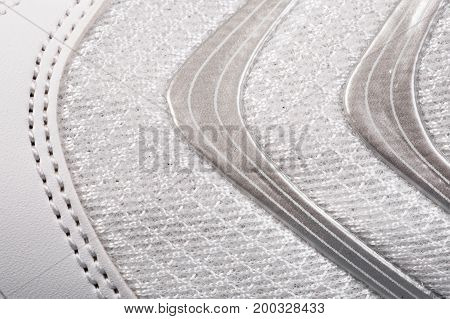 Sports shoes close up background. Texture of fabric macro background