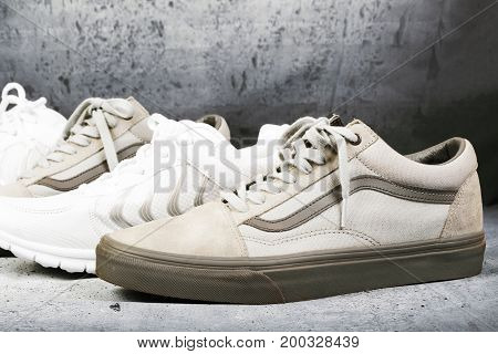 Sports man`s shoes on a concrete background