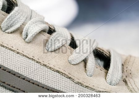 Men's sports shoes with laces close up background.