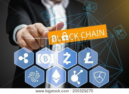 Concept of Business man points his finger at Blockchain Cryptocurrency
