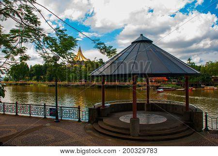 Pavilion Near The Water With Views Of The Dewan Undangan Negeri Sarawak. Kuching, Sarawak, Malaysia.
