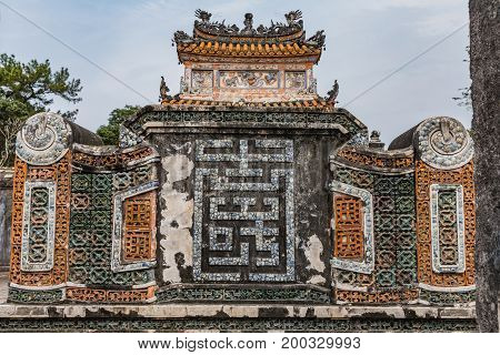 Detail of a ceramic mosaic. Royal town of Hue. Tomb of Emperor Khai Dinh(UNESCO World Heritage). Famous Historical site in Hue Vietnam.