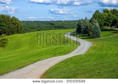 A winding leading to the original Woodstock concert grounds in Bethel NY.