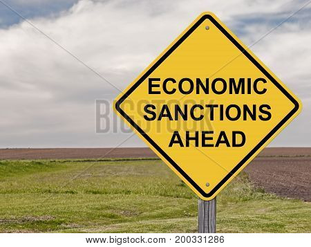 Caution Sign - Economic Sanctions Ahead Warning