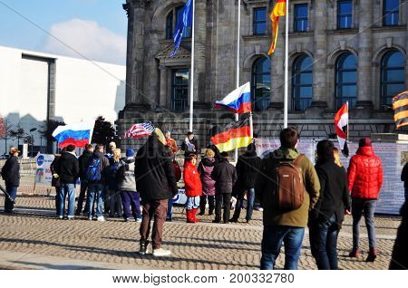 German People And Foreigner Travelers Walk And Posing For Take Photo At Front Of Reichstag Building