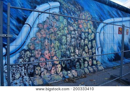 The Berlin Wall (painted On The Eastern And Western Side) Was A Barrier That Divided The City