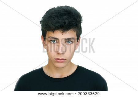 A teenager in a black shirt on a white background. Beautiful eyes a strong mind strong will to win. Isolated