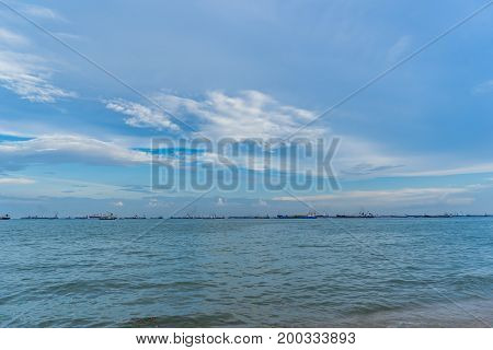 View of the sea from East Coast Park in Singapore under the beautiful blue sky with cloudy