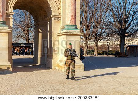 Paris, France - December 27, 2016 : The soldier with a gun patrols the territory of the Tuileries garden. Paris. France.