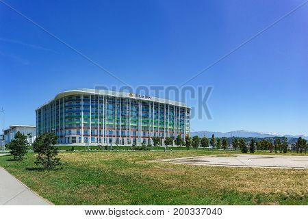 Russia, Sochi - June 05.2017: Olympic Avenue And The Building Of A Modern Hotel Tulip Inn Sunny Summ