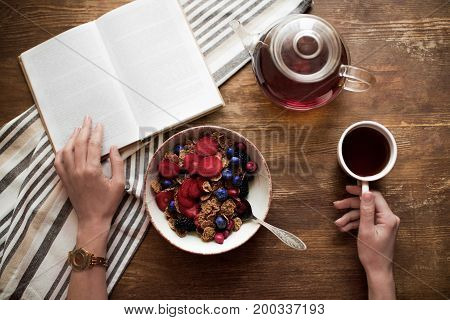 Woman Reading Book During Breakfast