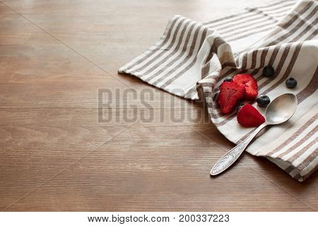 Berries And Spoon On Napkin