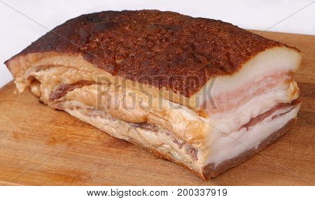 Smoked pork fat with on wooden deck