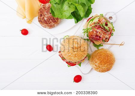 Big Sandwich - Hamburger Burger With Beef, Cheese, Tomato, Cucumber And Fried Bacon. Flat Lay. Top V