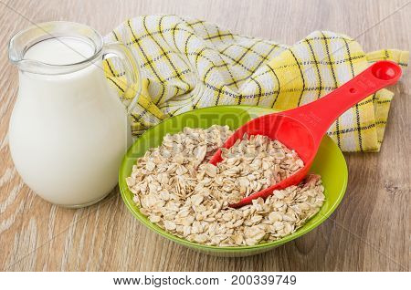 Spoon In Bowl With Oat Flakes, Jug Of Milk, Napkin