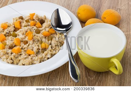 Porridge From Oat Flakes With Pieces Of Fruits, Milk