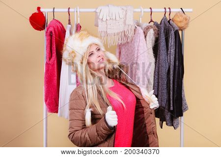 Woman Picking Winter Outfit In Wardrobe