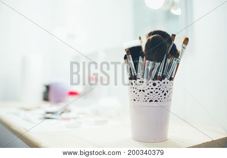 Set of make-up brushes on the table, make-up tools.