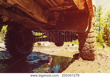Bottom View To Big Offroad Car Wheel On Country Road