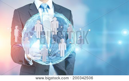 Close up of an unrecognizable man interacting with an Earth hologram and a network sketch. Blurred office background. Toned image double exposure mock up