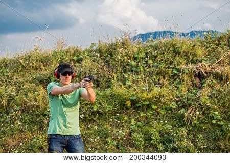 Handsome Caucasian Military Policeman Special Forces Army Guy At Training Battleground Field Shootin