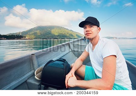 Man Traveling By Boat To Tropical Island