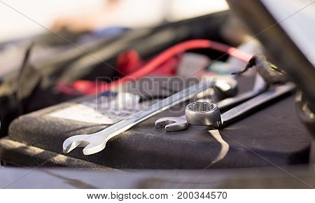 Metal wrench fixing tool for repairing problematic car.