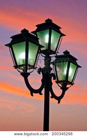 Closeup of a lanterns at sunset in portrait orientation