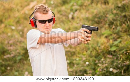 Handsome And Young Blond Policeman Professional Army Special Force Training Guy Shoot From Fire Arms