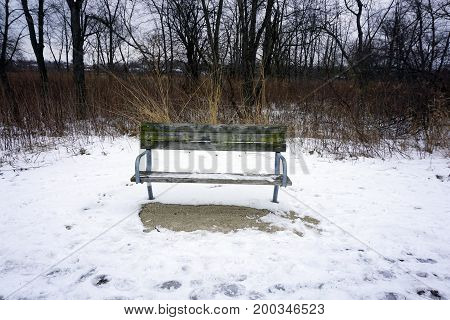 A bench along the Rock Run Greenway Trail, which runs through the Rock Run Preserve in Joliet, Illinois, during January.